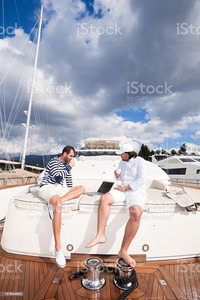 Businessman and captain on the luxury yacht royalty-free stock photo