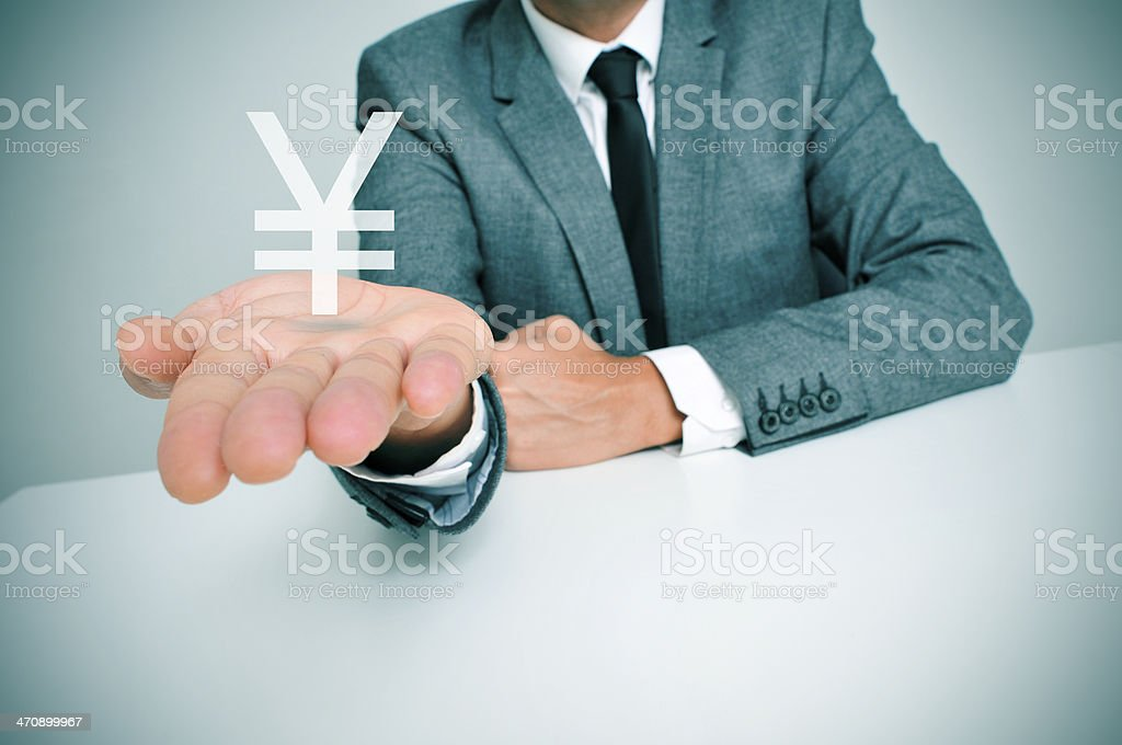 businessman and chinese yuan or japanese yen sign stock photo