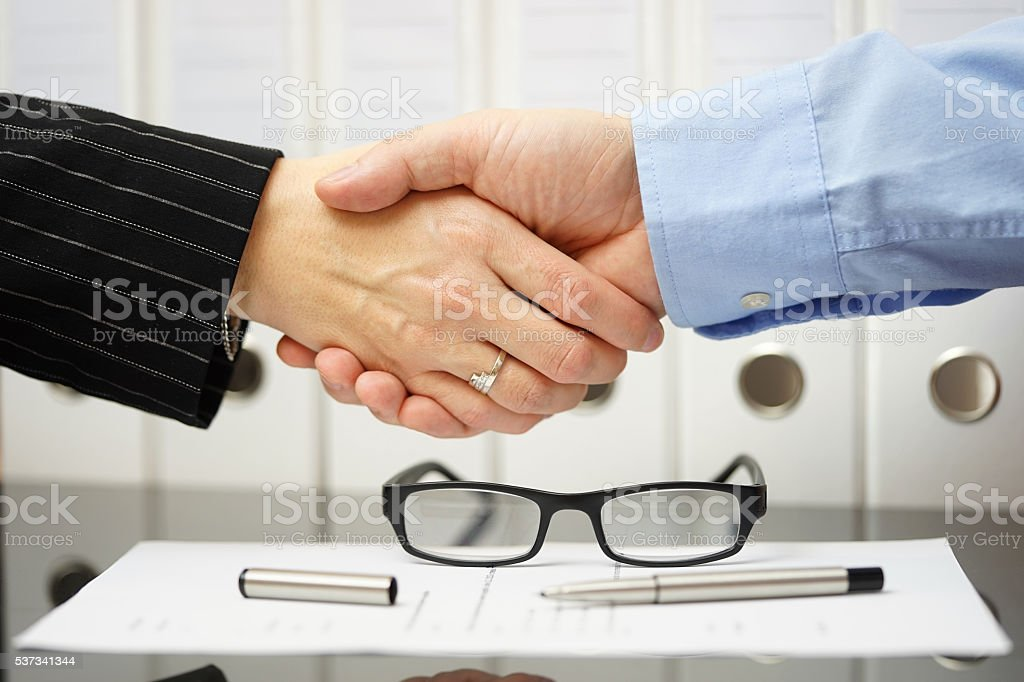 Businessman and client are handshaking over very good agreement stock photo