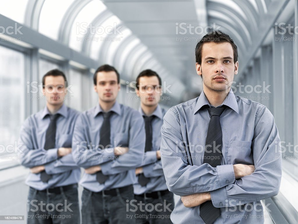 Businessman and clones royalty-free stock photo