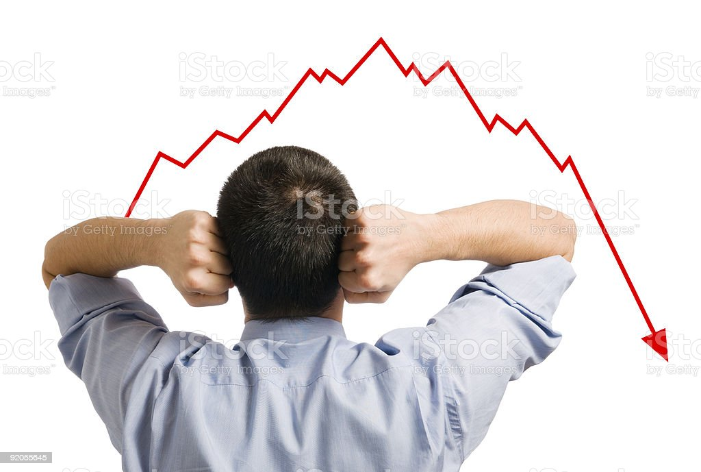 Businessman and declining share stock photo