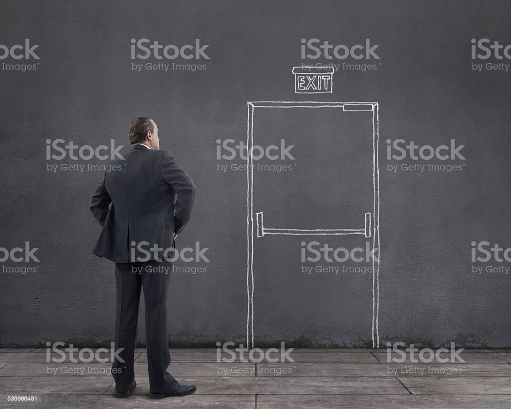 Businessman and Emergency Exit Door stock photo