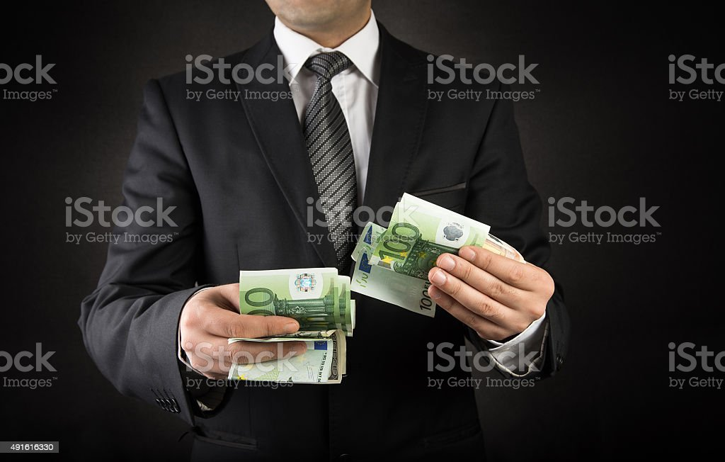 Businessman and Euro stock photo