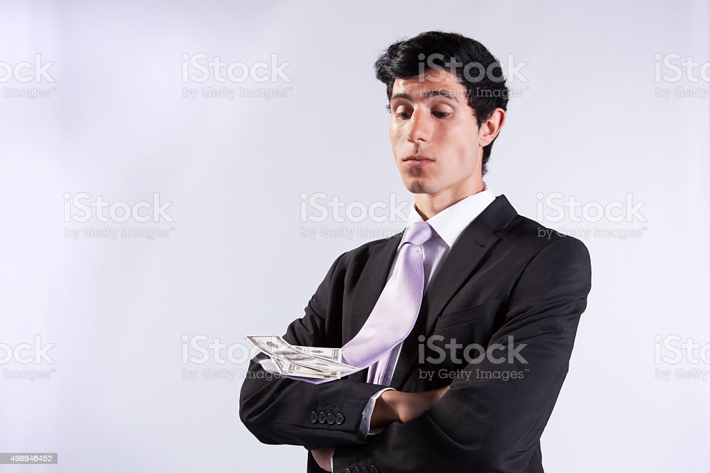 Businessman and flying necktie with money stock photo