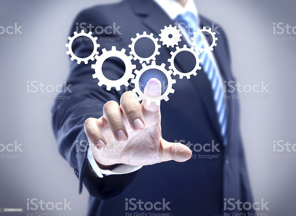 Businessman and gears stock photo