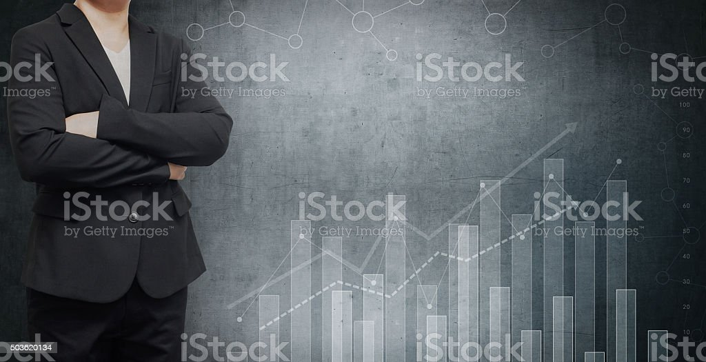 Businessman and graph finance on a abstract background. stock photo