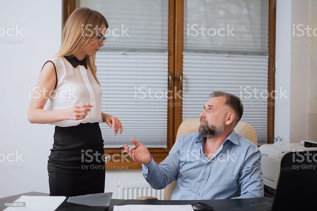 Businessman and his assistant Secretary in his office. stock photo