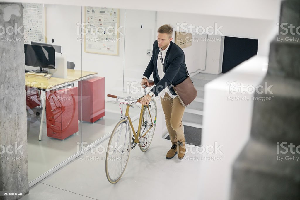 Businessman and his bicycle stock photo