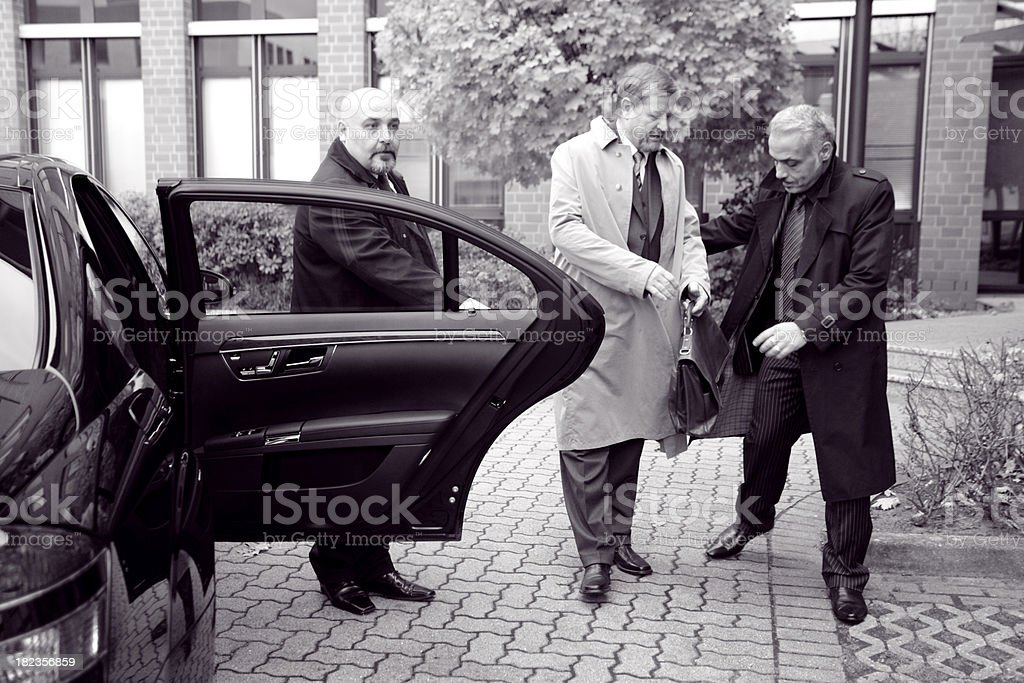Businessman and his Bodyguards royalty-free stock photo