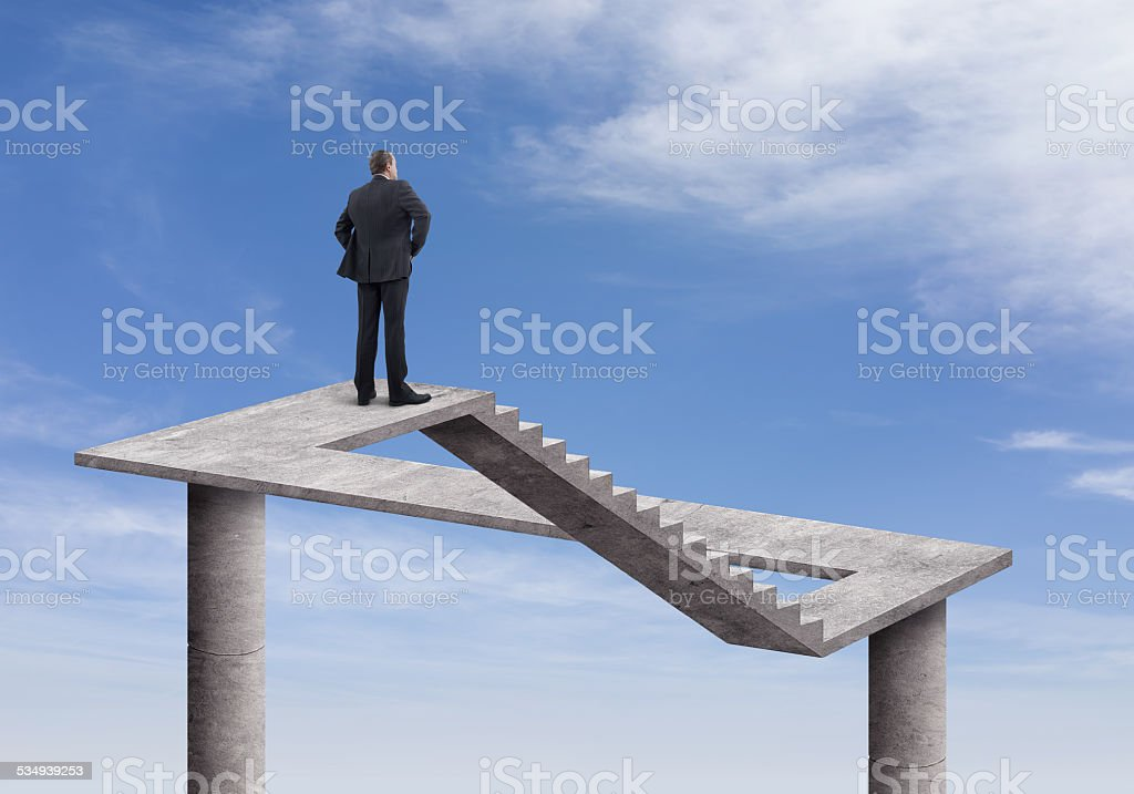 Businessman and Impossible Staircase stock photo