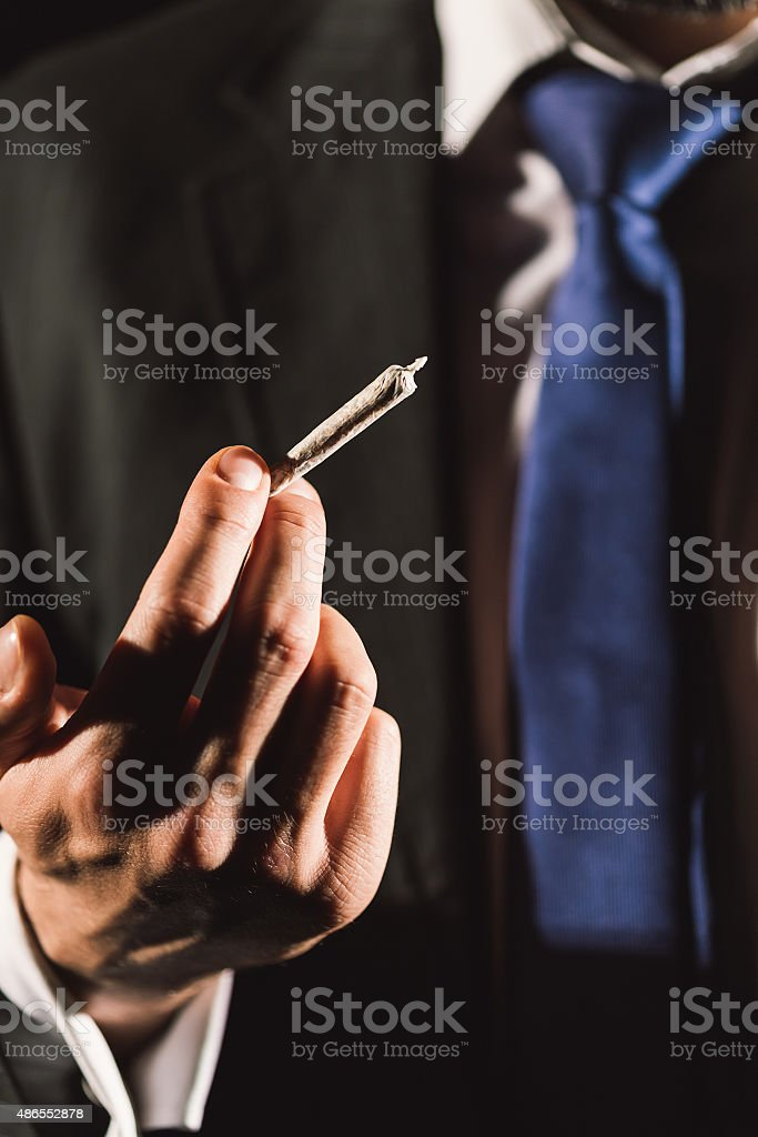 Businessman and joint stock photo