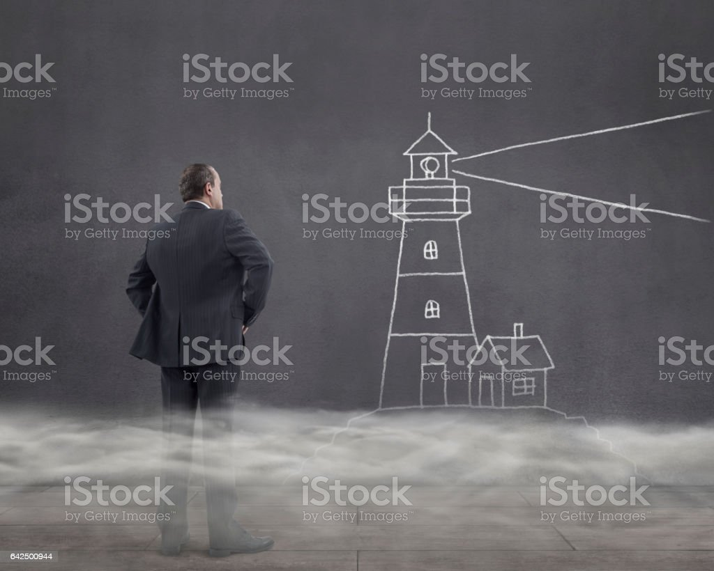 Businessman and Lighthouse Sketched in Foggy Room stock photo