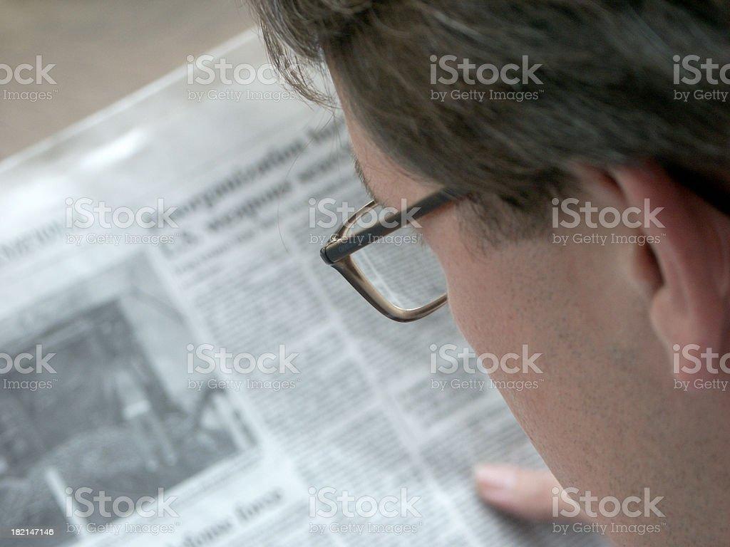 Businessman and Newspaper stock photo