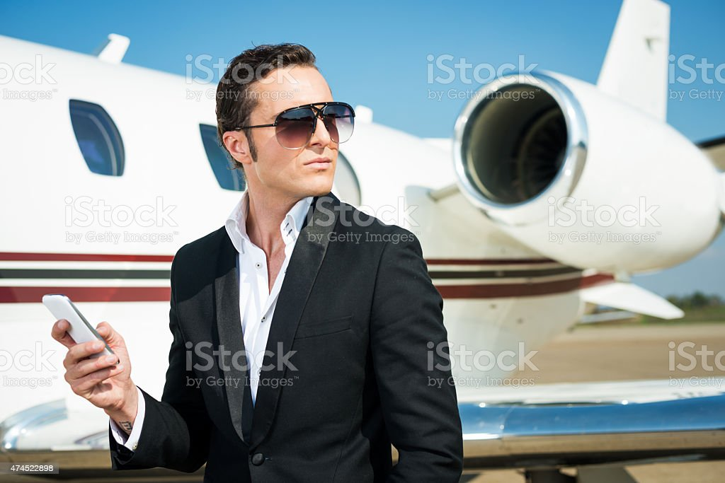 Businessman and private jet airplane stock photo