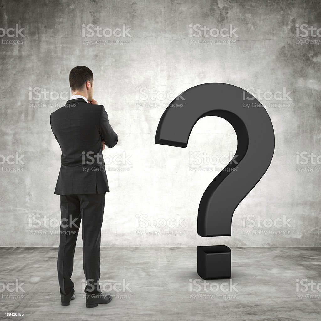 businessman and question mark stock photo