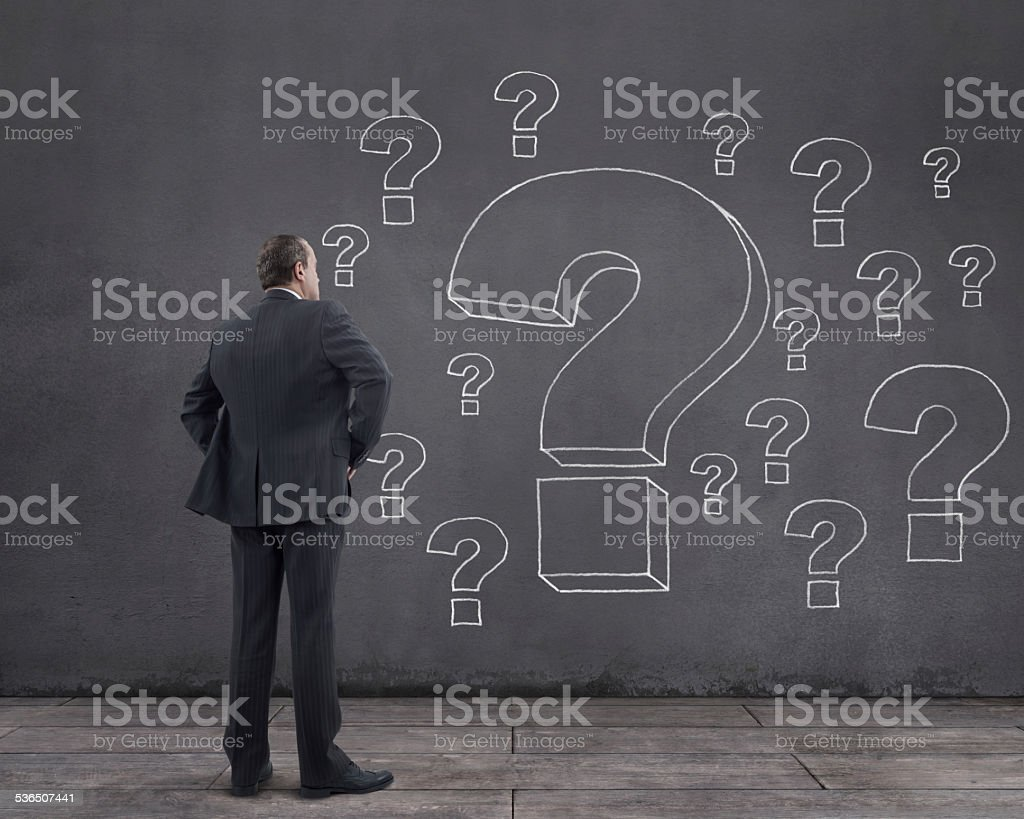 Businessman and Question Marks stock photo
