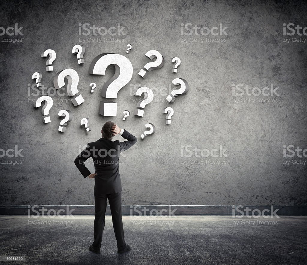 Businessman and questions stock photo