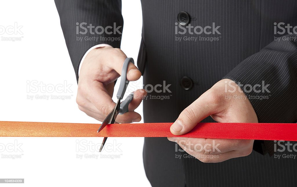Businessman and red ribbon. Isolated on white background stock photo