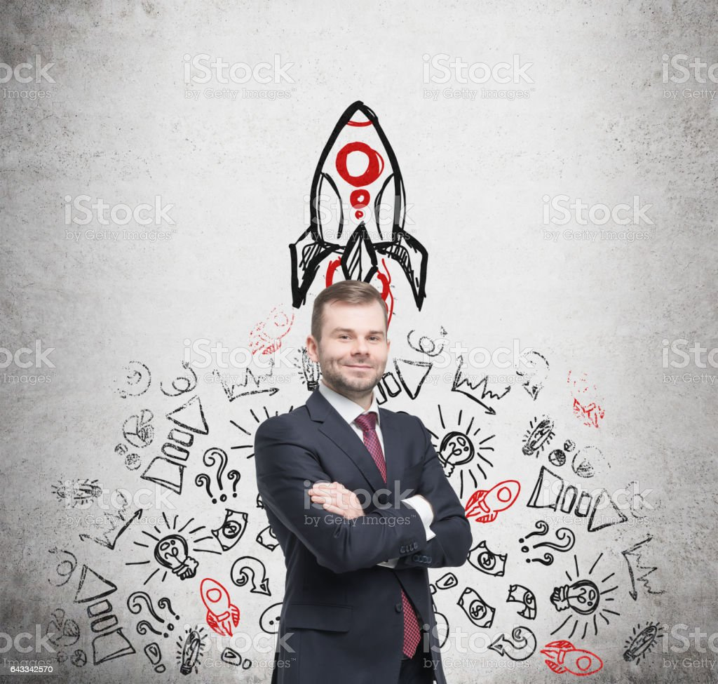 Businessman and rocket sketch on concrete stock photo