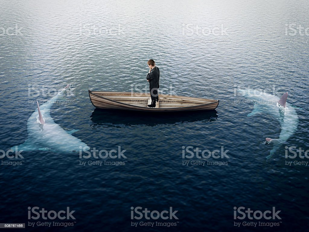 businessman and sharks stock photo
