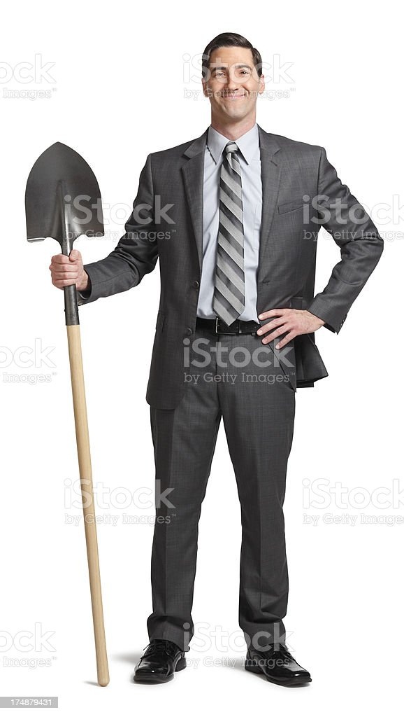 Businessman and Shovel royalty-free stock photo