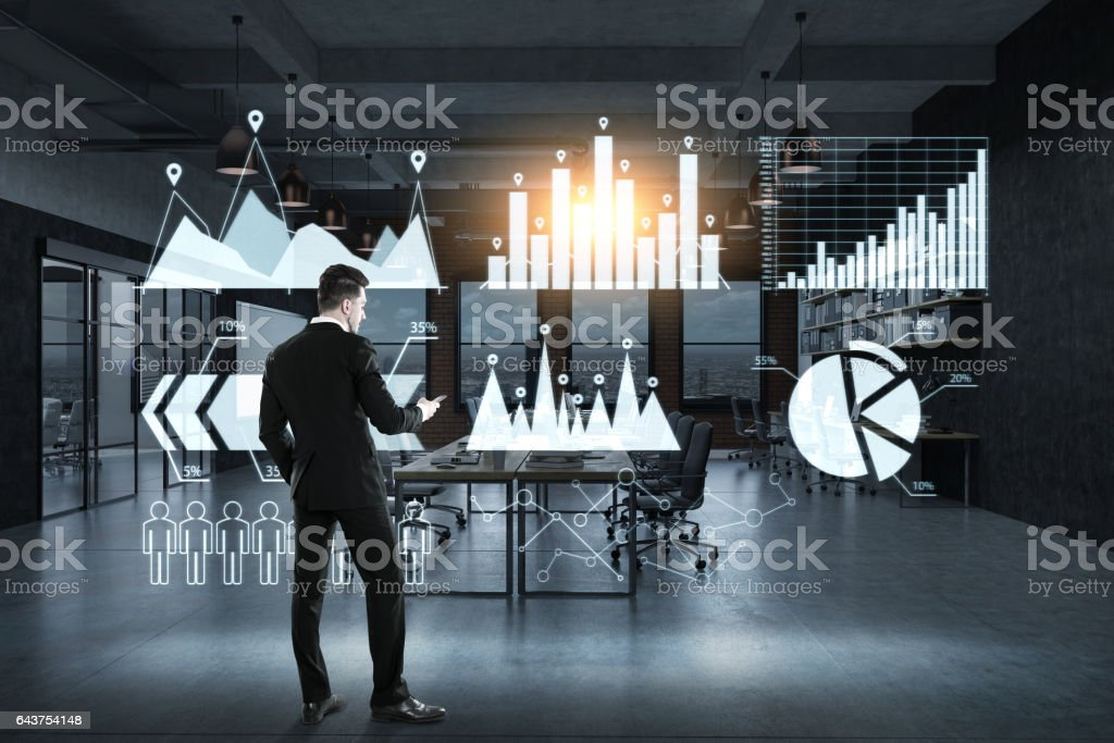 Businessman and six graphs on glassboard stock photo