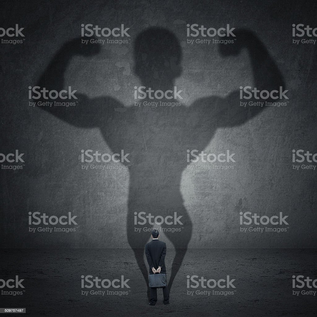 Businessman and strong shadow 1 stock photo