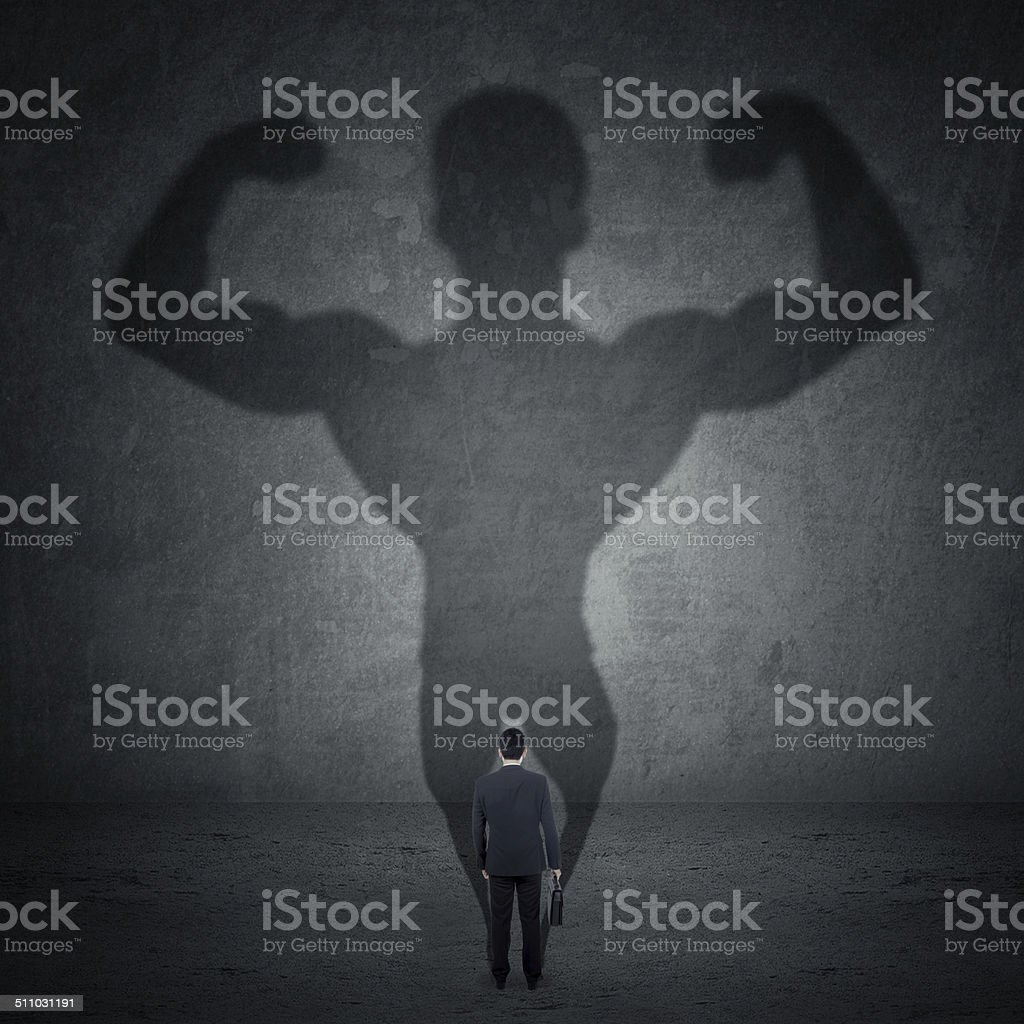 Businessman and strong shadow 5 stock photo