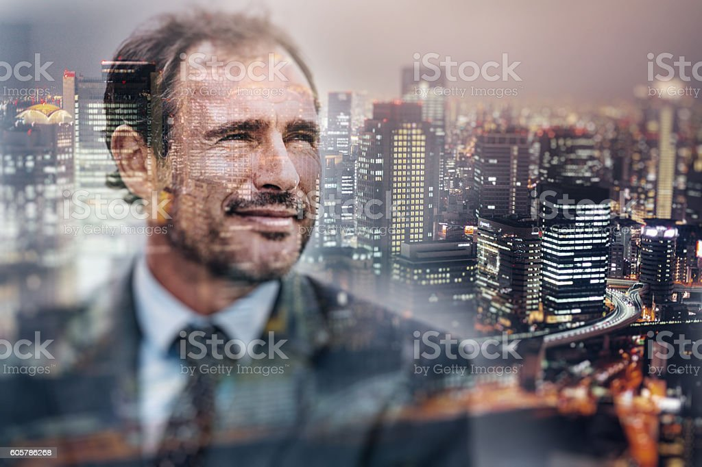 Businessman and the city stock photo