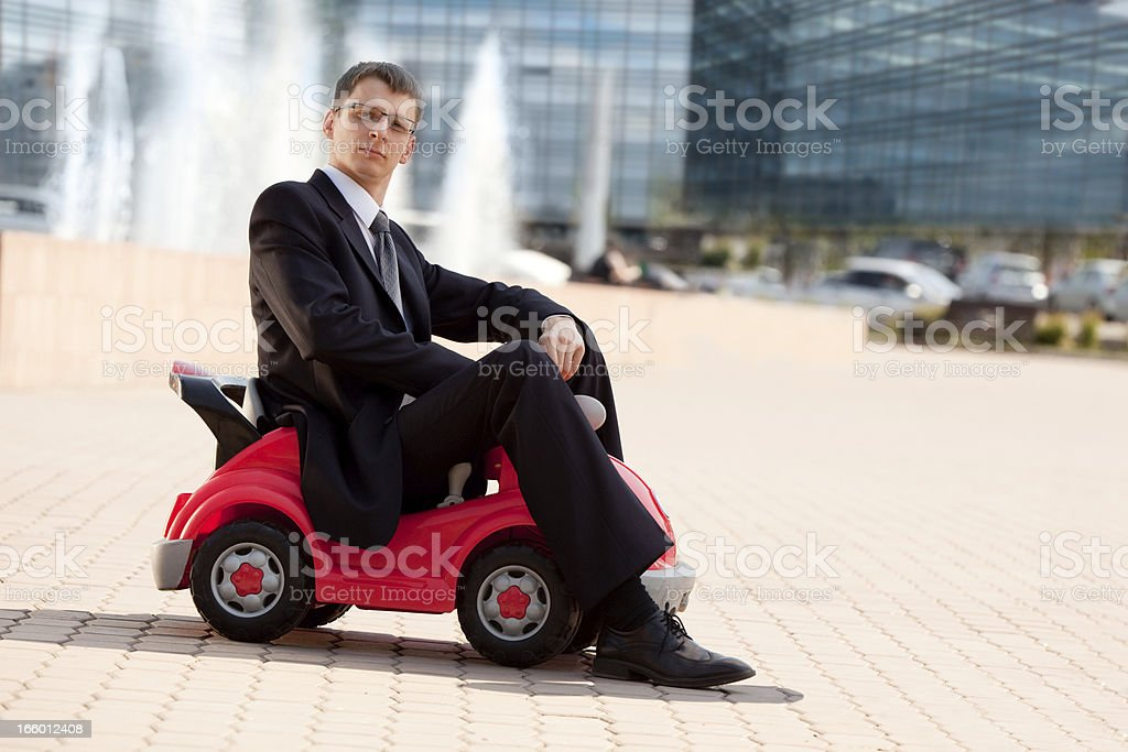 Businessman and Toy Red Car . stock photo