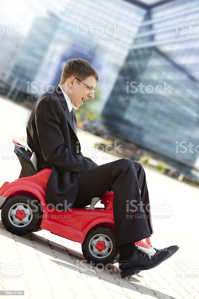 Businessman and Toy Red Car . royalty-free stock photo
