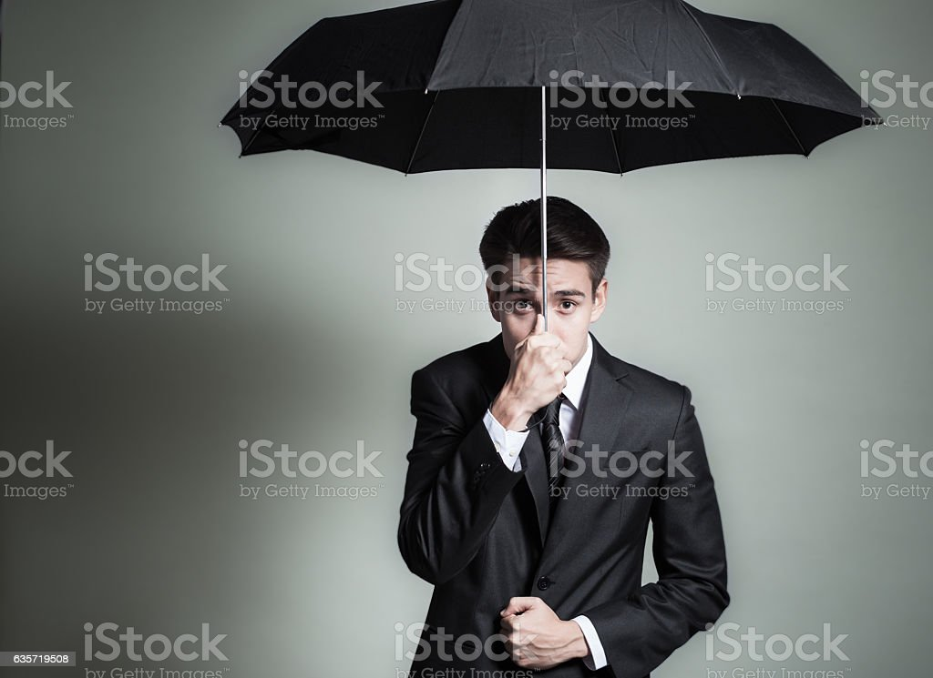 Businessman and umbrella stock photo
