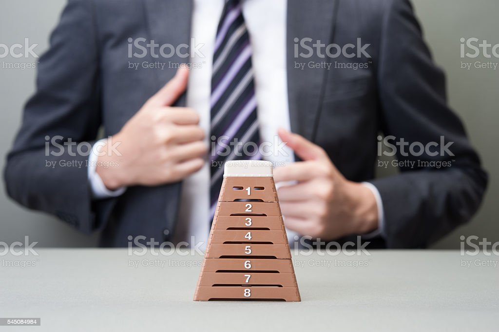 Businessman and vaulting horse stock photo