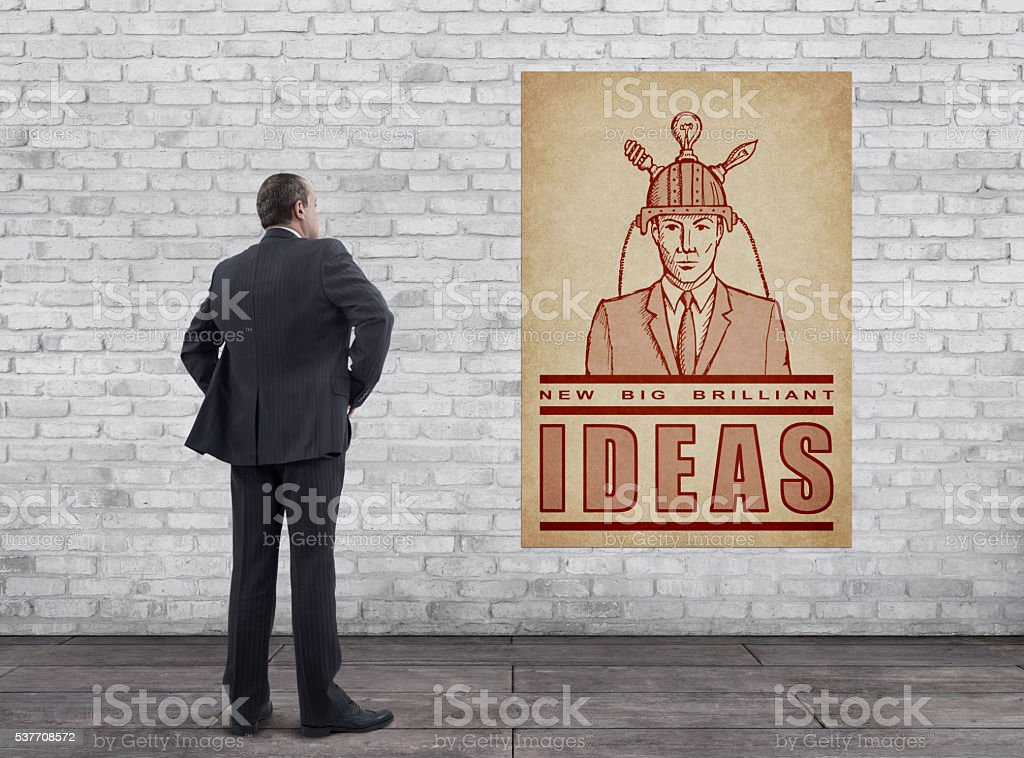 "Businessman and Vintage Style ""NEW, BIG, BRILLIANT IDEAS"" Poster stock photo"