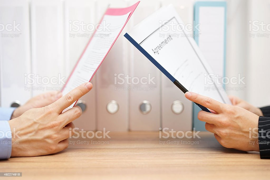 businessman and woman are reading agreement stock photo
