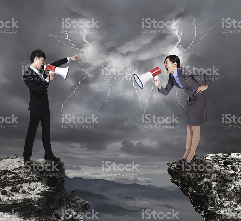 Businessman and woman arguing with screams and a loudspeaker stock photo