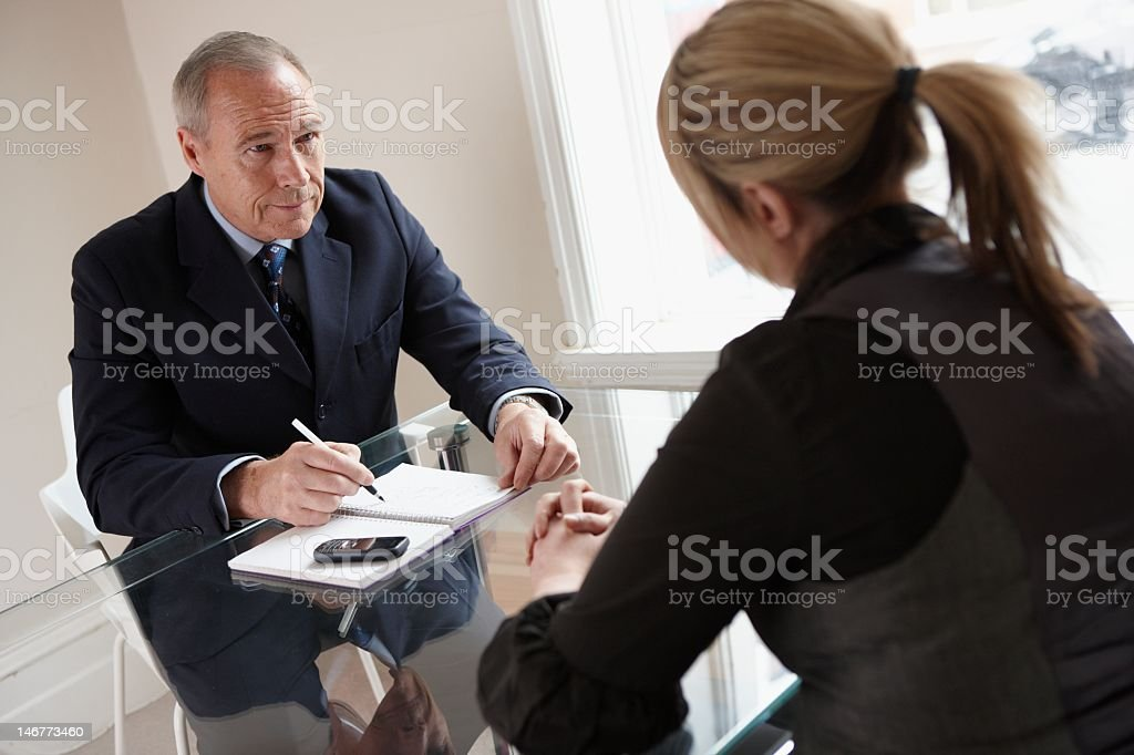 Businessman and woman during a job interview royalty-free stock photo