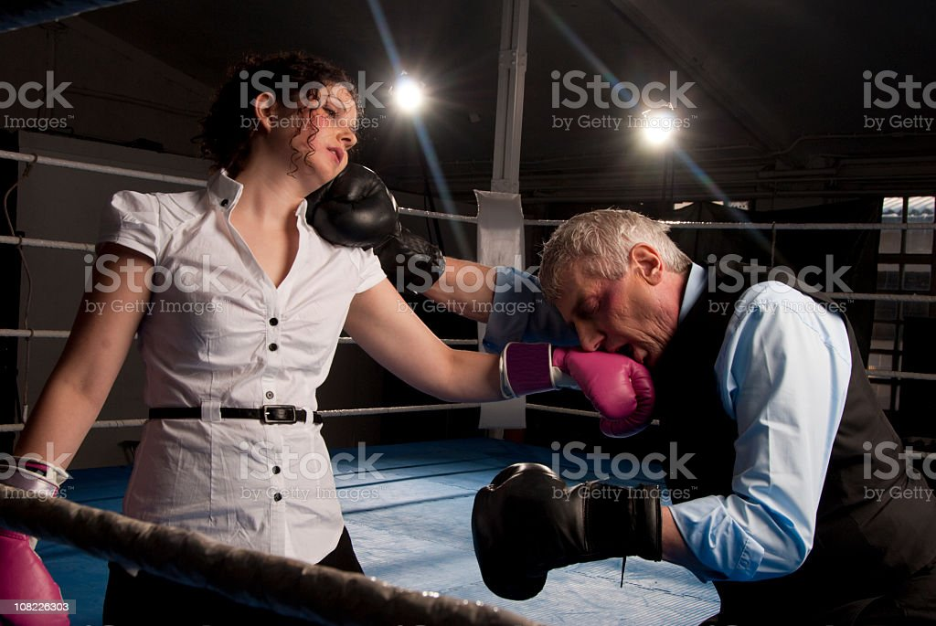Businessman and Woman in boxing match stock photo