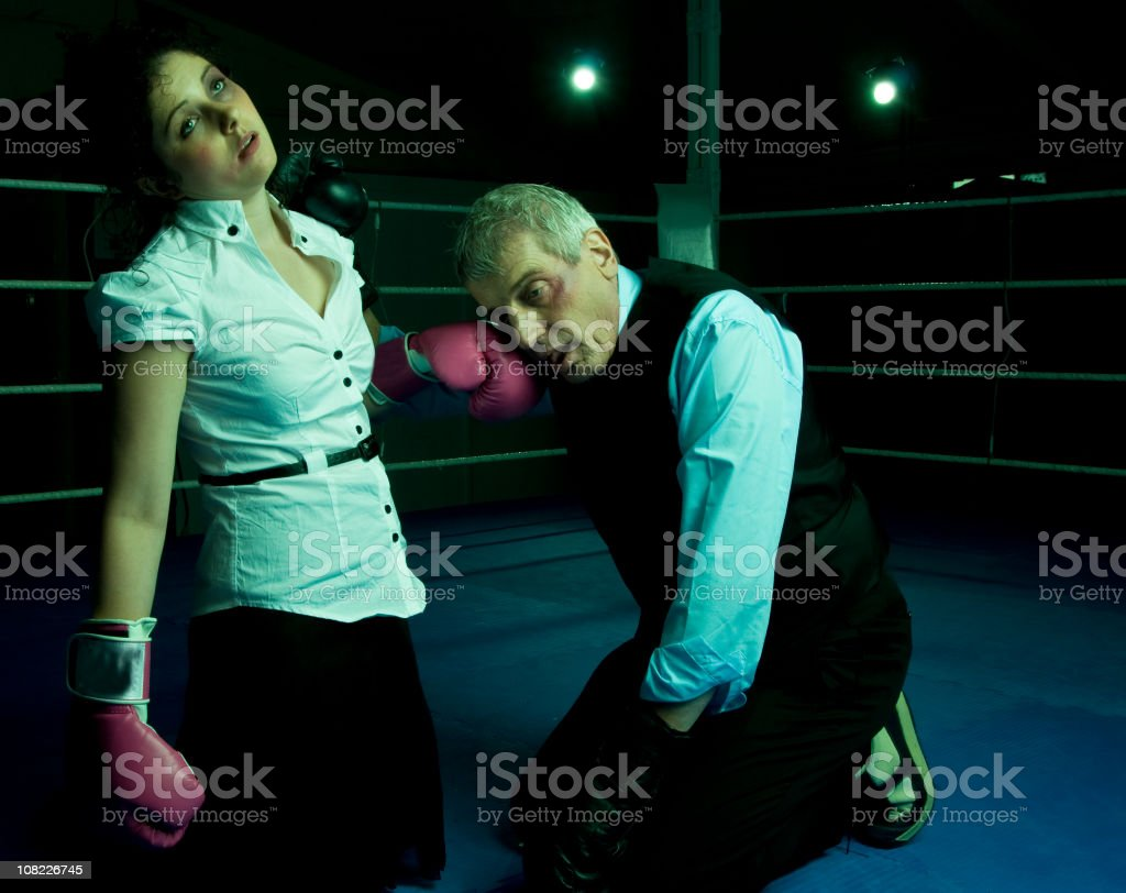 Businessman and Woman in Boxing Ring stock photo