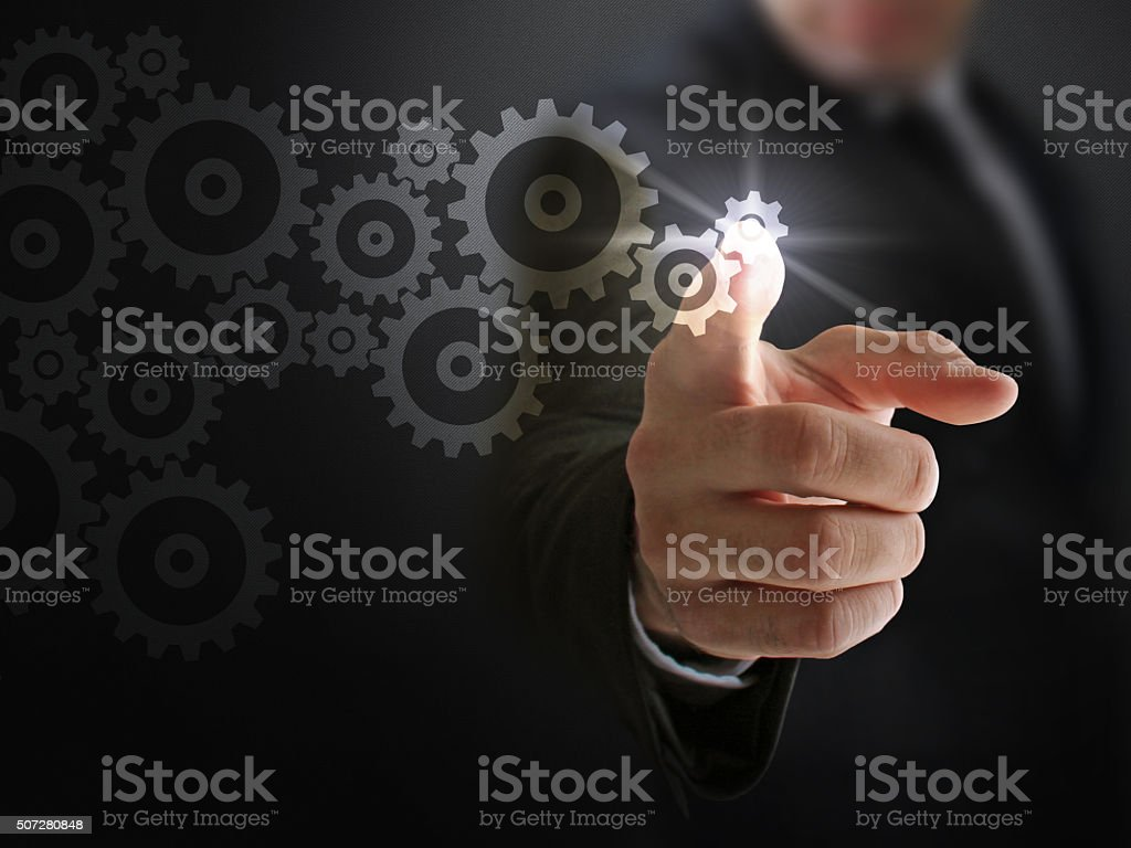 Businessman and Working Gears of Industry stock photo