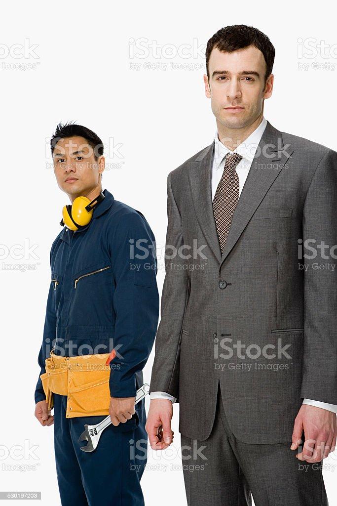 Businessman and workman stock photo
