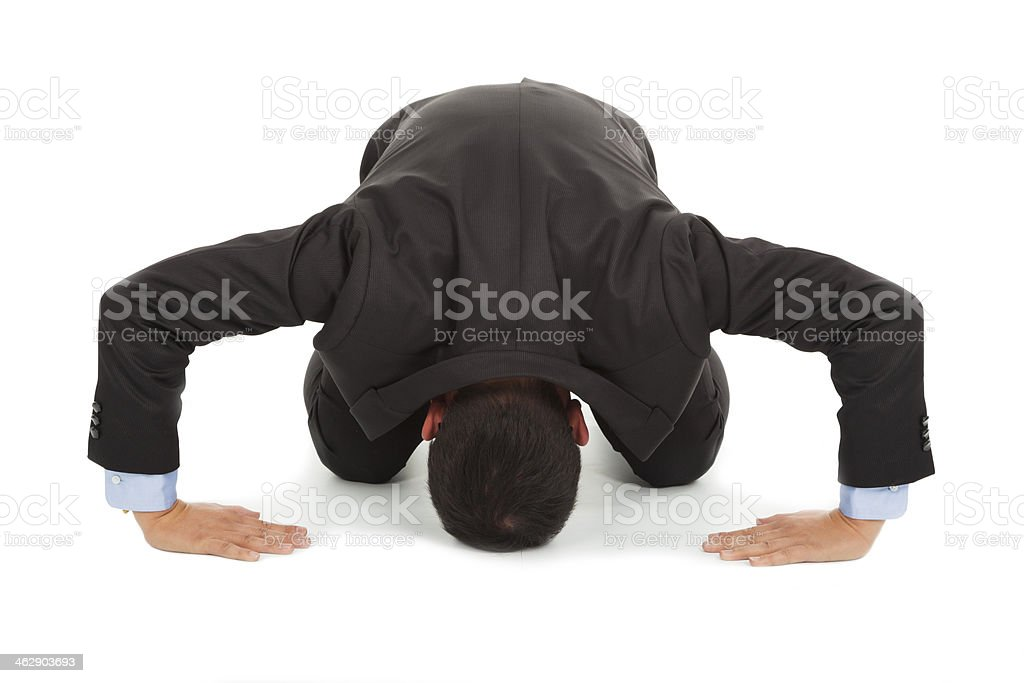 Businessman apologizing in Japanese kneeling position stock photo