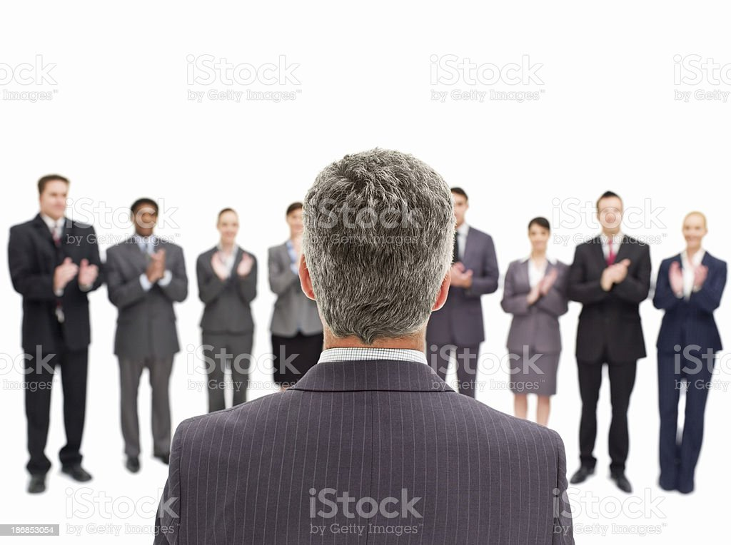 Businessman Applauded by Colleagues royalty-free stock photo