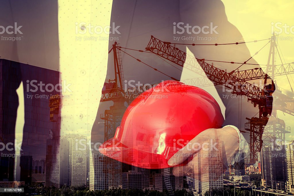 Businessman architect engineer holding a safety helmet stock photo