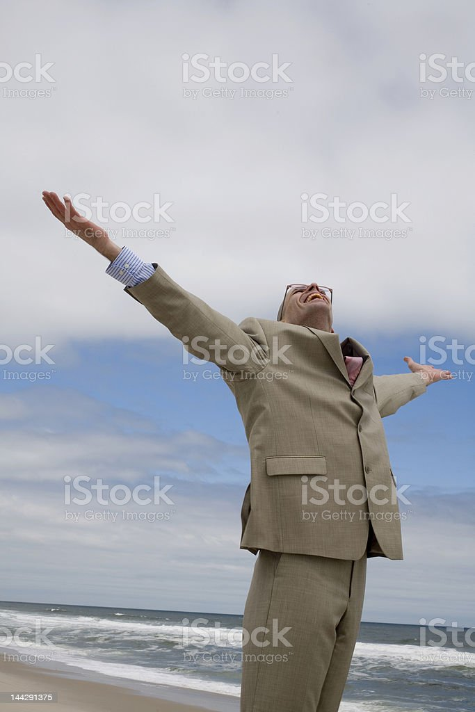Businessman Arm Stretched under the Sky stock photo
