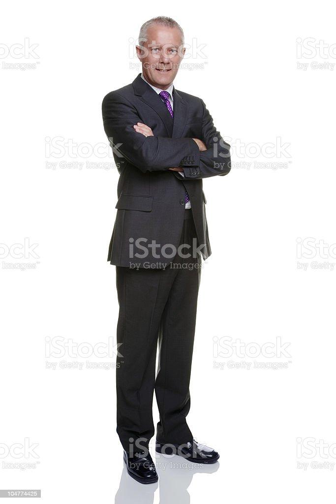 Businessman arms folded stock photo