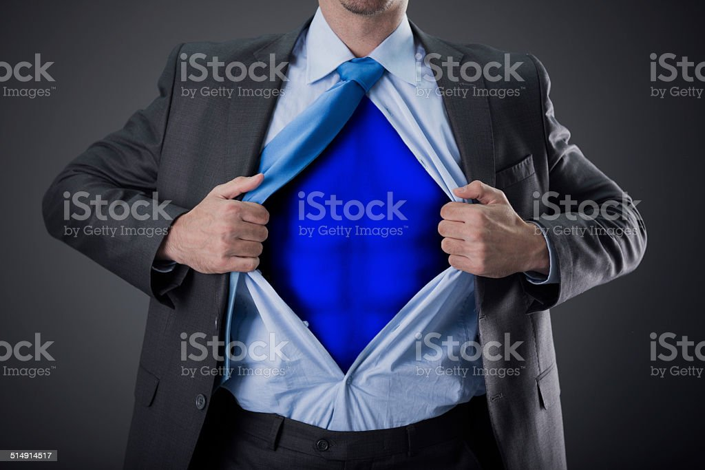 businessman as super hero and tearing his shirt stock photo
