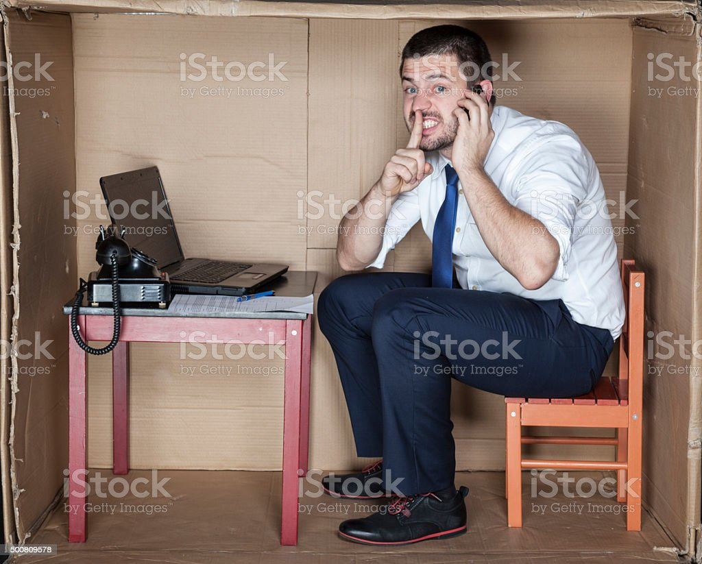 businessman ask for silence during his conversation stock photo