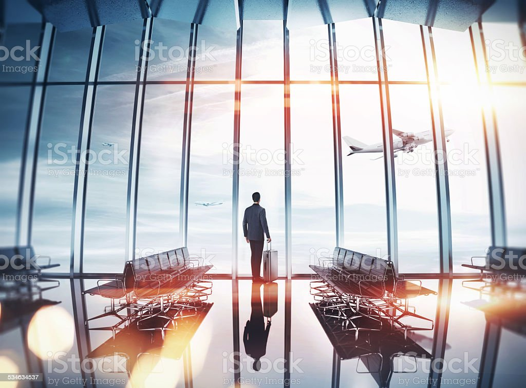 Businessman at airport near the window stock photo