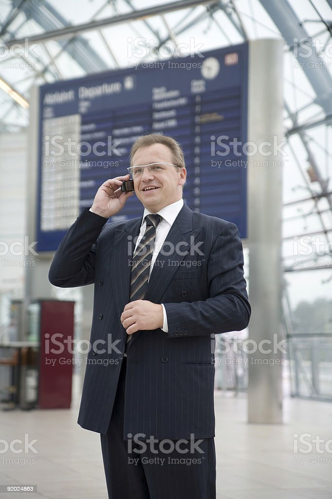 Businessman at airport, smiling face royalty-free stock photo